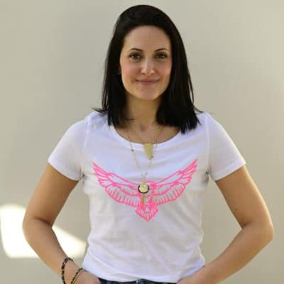 White scoop neck tee with a neon pink eagle motif.